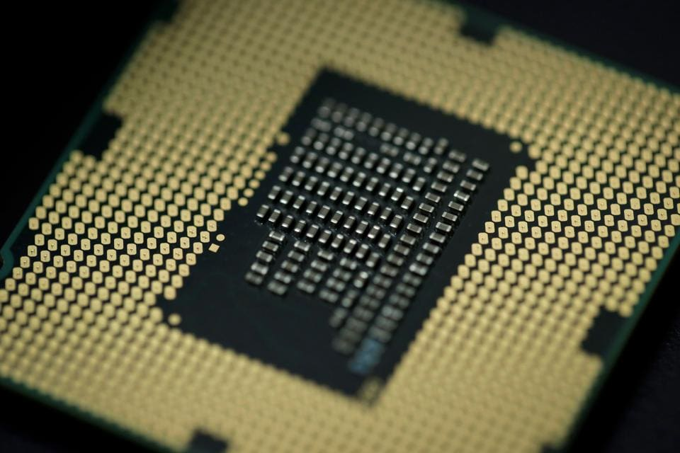 A computer processor is pictured on January 5, 2018 in Paris. As tech giants race against the clock to fix major security flaws in microprocessors, many users are wondering what lurks behind unsettling names like