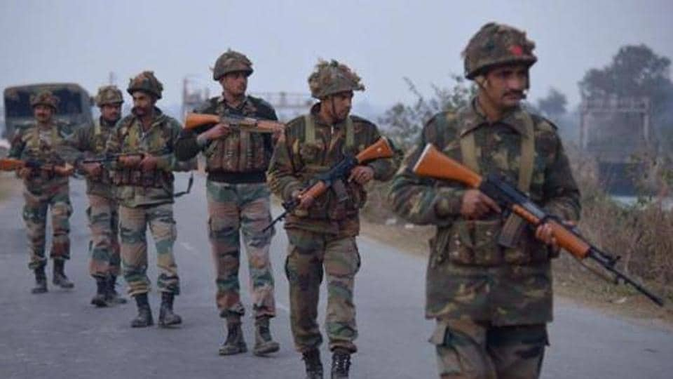 Indian Army personnel patrol near the Air Force Base in Pathankot on January 2, 2016 during an ongoing attack on the base by suspected militants. Gunmen wearing army uniforms had infiltrated the installation in Punjab.