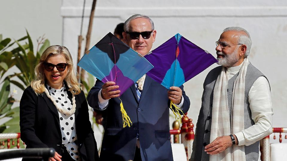 Benjamin Netanyahu holds kites as his wife Sara and PM Narendra Modi look on at Gandhi Ashram. The two leaders are scheduled to visit a centre for agriculture in Sabarkantha. (Amit Dave / REUTERS)