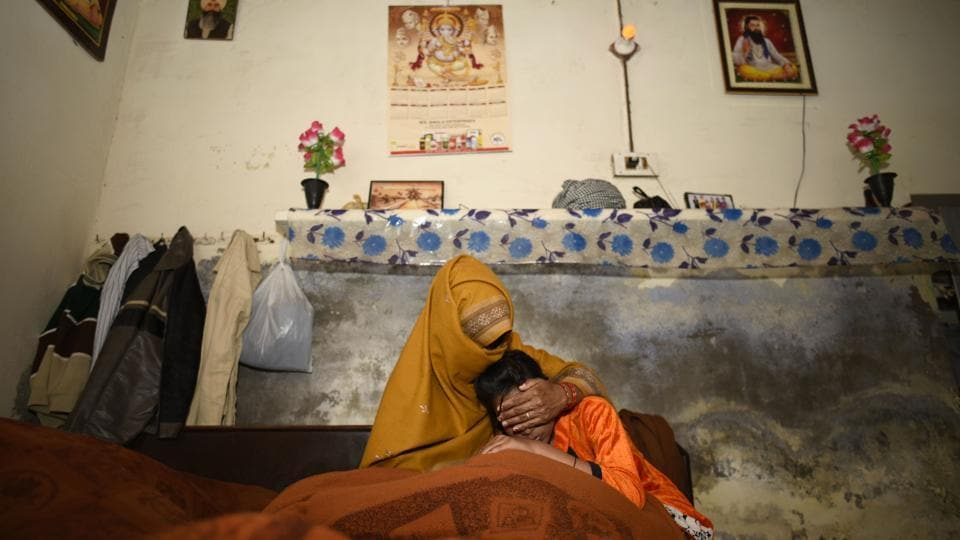 The mother and younger sister of the rape-murder victim at their village in Jhansa in Haryana.