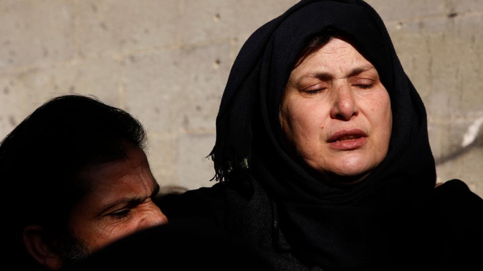 The mother of Palestinian Ahmed Saleem, 24, mourns during his funeral in Jayus village near the town of Qalqilya on  after he was shot dead by the Israeli military the previous day in the occupied West Bank. Saleem was the 17th Palestinian to be killed since US President Donald Trump's declaration of Jerusalem as Israel's capital.
