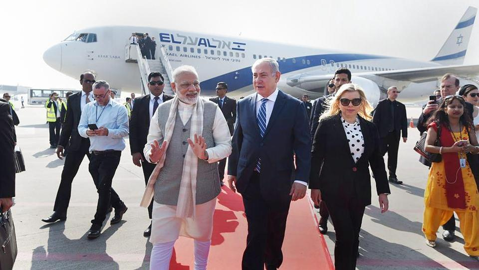 Prime Minister Modi, receives his Israeli counterpart Benjamin Netanyahu and his wife Sara Netanyahu as they arrive at Sardar Vallabhbhai Patel International airport in Ahmedabad. (PTI)