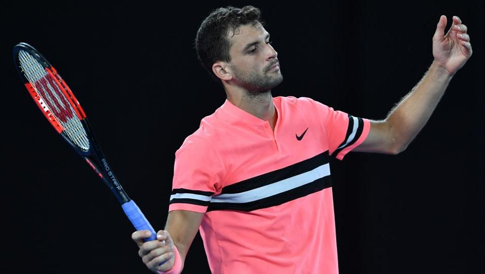 Bulgaria's Grigor Dimitrov had to fight it out against Mackenzie McDonald of the US (C) to progress at the Australian Open tennis tournament in Melbourne.