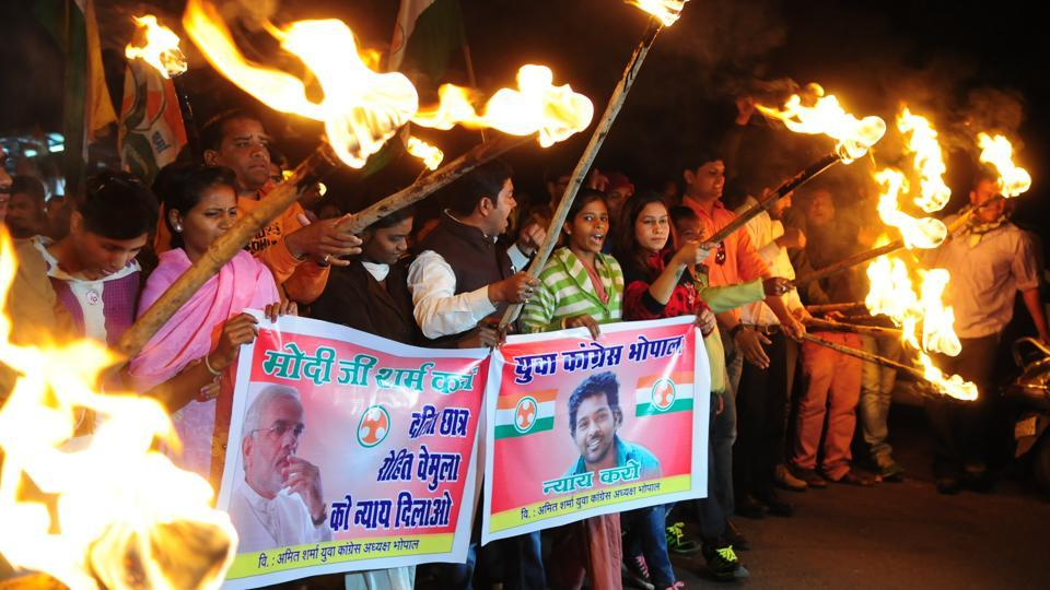 "Youth Congress workers take part in a torch rally demanding justice for Vemula in Bhopal. ""The university authorities, the Centre and the state government might have thought the Rohith episode was a closed chapter. So long as the issues for which he attained martyrdom remain, his memories will continue to haunt the university and government,"" said Dontha Prashanth, a leader of the Ambedkar Students Union, at Hyderabad University. (Mujeeb Faruqui / HT Photo)"