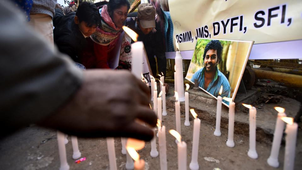 Activists of various organizations take part in a candle-light march to observe Vemula's first death anniversary in New Delhi. 'Justice for Rohith Vemula,' a committee of students and faculty members, will observe 'Rohith Shahadat Day' — or martyrdom day — on January 17 and hold a convention at the University of Hyderabad auditorium to discuss discrimination against Dalits. (Virendra Singh Gosain / HT Photo)