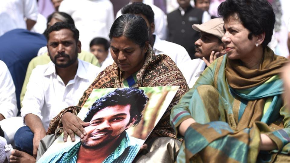"Members of the Youth Congress along with Vemula's mother Radhika (centre) during a protest in New Delhi. ""His family story haunted Rohith all his life,"" said Riyaz. ""He faced caste discrimination in the house where he grew up. But instead of succumbing, Rohith fought it out. He broke many barriers before he got to the final stretch, his PhD."" (Arun Sharma / HT Photo)"