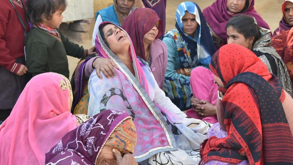Family members of the boy who was killed in a crossfire in Mathura village on Wednesday.