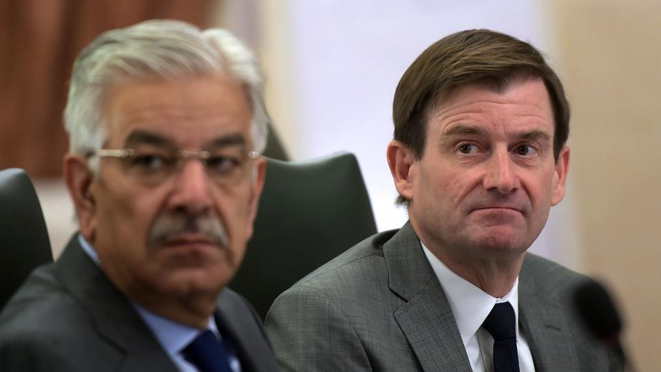 This file photo taken on November 6, 2017 shows US ambassador to Pakistan David Hale (R) and Pakistani foreign minister Khawaja Muhammad Asif attending the 4th Round of the US-Pakistan bilateral dialogue in Islamabad.
