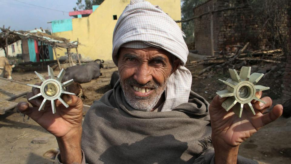 A villager shows a mortar shell allegedly fired on a residential area from the Pakistan side at the India-Pakistan international border at Pindi Camp in Arnia Sector about 40km from Jammu on Thursday.
