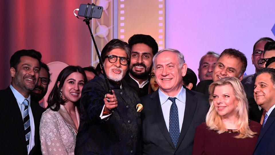 Amitabh Bachchan takes a selfie with Israeli Prime Minister Benjamin Netanyahu and other Bollywood personalities during 'Shalom Bollywood', an evening to celebrate Israeli and Indian Bollywood relations during his visit in Mumbai on Thursday.