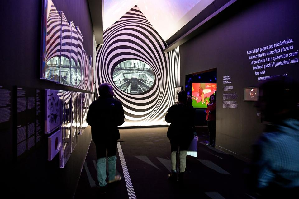 Visitors in the 'Down the rabbit hole' room, during the 'The Pink Floyd Exhibition: Their Mortal Remains' preview. The exhibition marks the first collaboration in decades of Pink Floyd's remaining members and is promoted by Michael Cohl (Andreas Solaro / AFP)