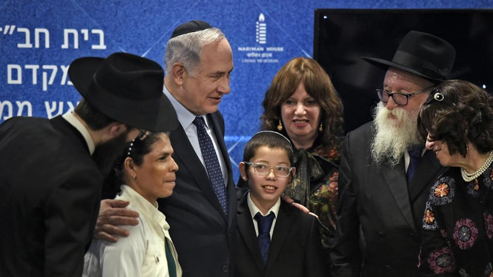 Israeli Prime Minister Benjamin Netanyahu with Moshe Holtzberg, his nanny and grandparents after unveiling the Living Memorial in commemoration of the victims of the 26/11 attacks, at the Chabad House in Mumbai on Thursday.