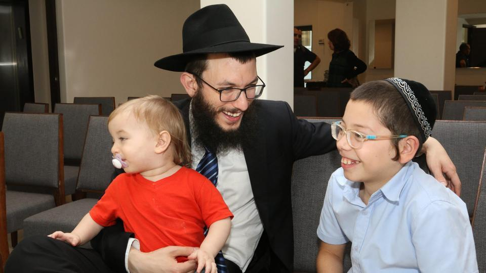 Rabbi Yisroel Kozlovsky with Moshe Holtzberg, at Chabad House in Mumbai on Tuesday. The visit comes six months after the young boy met Prime Minister Narendra Modi on July 5, 2017, and expressed a desire to visit the country. India then issued 10-year multiple entry visas to Moshe and his grandparents. (PTI)