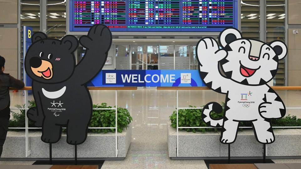 The mascots of the 2018 Pyeongchang Winter Olympics at the arrival gate of Terminal 2 of Incheon International Airport, west of Seoul, on Thursday. Incheon airport, South Korea's top gateway, opened its second terminal, three weeks before the opening of the Pyeongchang Olympics.