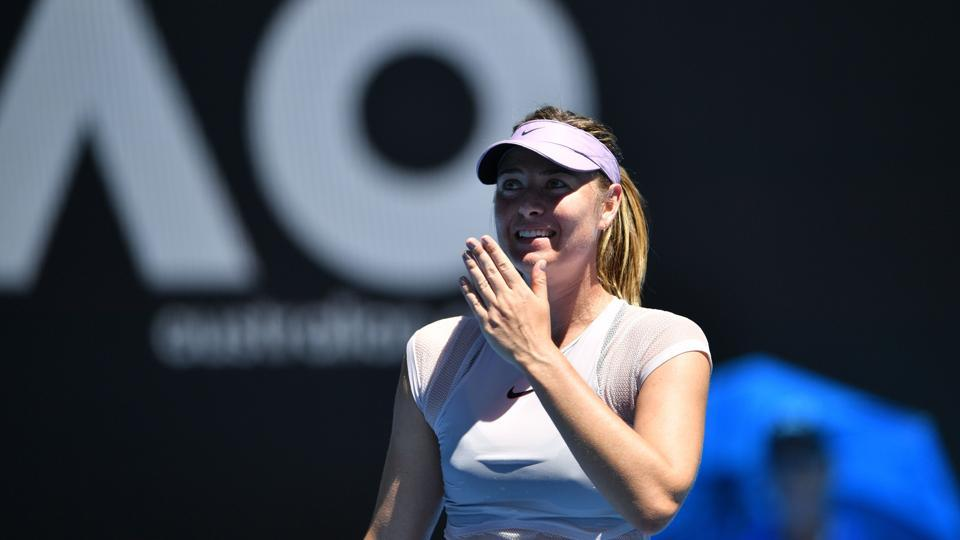 Russia's Maria Sharapova reacts after beating Latvia's Anastasija Sevastova in their women's singles second round match on Day 4 of the Australian Open tennis tournament in Melbourne