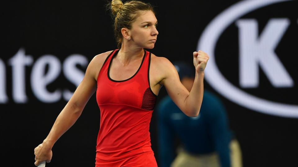 Romania's Simona Halep reacts after beating Canada's Eugenie Bouchard in their women's singles second round on Day 4 of the Australian Open tennis tournament in Melbourne.