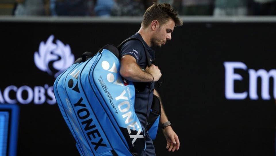 Switzerland's Stan Wawrinka walks off the court after losing to American tennis player Tennys Sandgren at the Margaret Court Arena. (REUTERS)