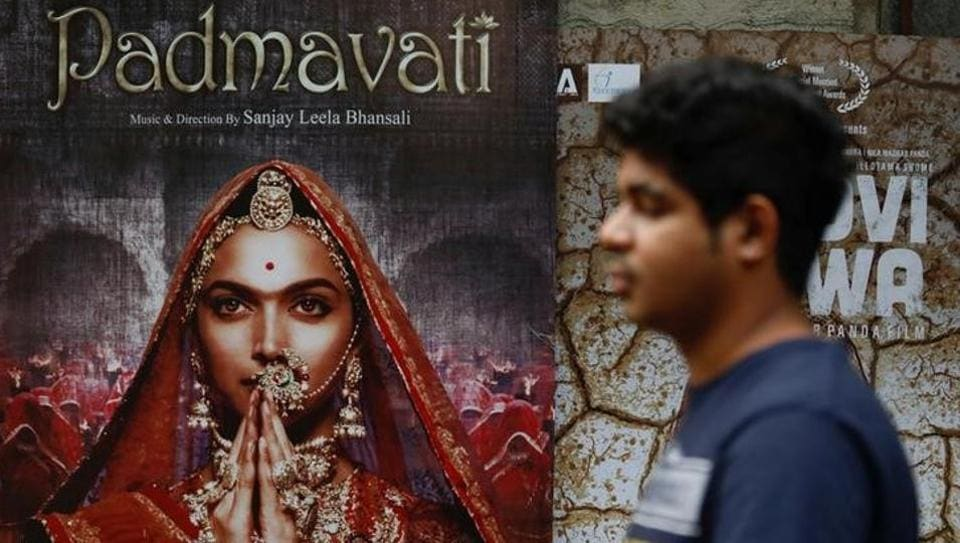A man walks past a poster of the movie 'Padmavati', now renamed 'Padmaavat' outside a theatre in Mumbai on November 21, 2017. The Supreme Court has stayed a ban on the film imposed by Gujarat, Rajasthan, Haryana and Madhya Pradesh despite being cleared by the Central Board of Film Certification (CBFC), ensuring an all India release of the Sanjay Leela Bhansali film on January 25. (Danish Siddiqui / REUTERSFile)