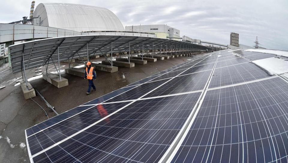A photo shows photovoltaic panels on a one-megawatt power plant. India, which receives twice as much sunshine as European nations, wants to make solar central to its renewable expansion.