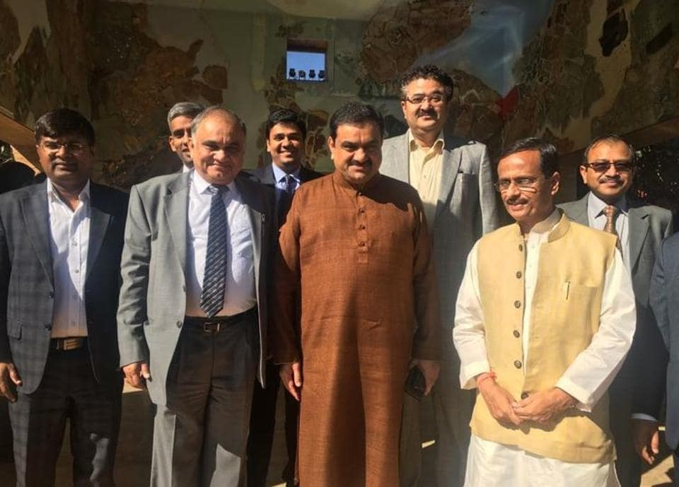Deputy chief minister Dinesh Sharma with industrialist Gautam Adani and other members of Team UP in Ahmedabad.