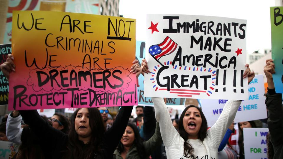 People participate in a protest march calling for human rights and dignity for immigrants, in Los Angeles, February 18, 2017.