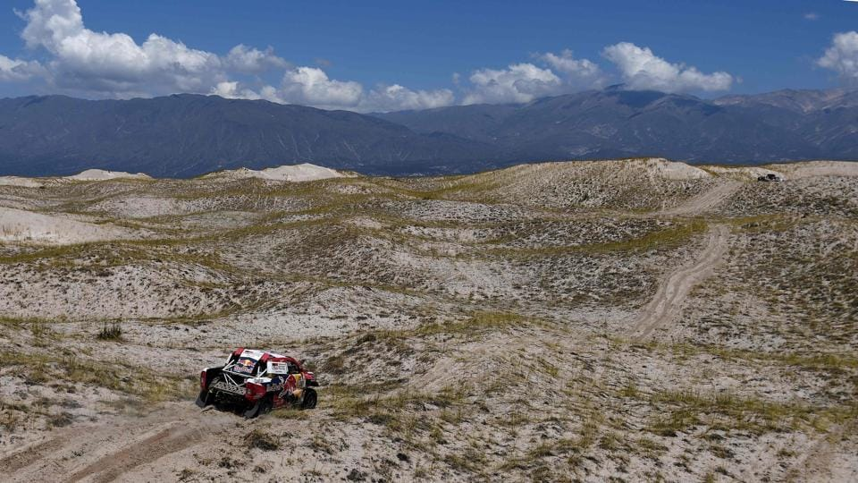 Toyota's Nasser Al-Attiyah of Qatar and his co-driver Mathieu Baumel of France reach a high altitude pass during Stage 10 between Salta and Belen, Argentina. (Franck Fife / AFP)
