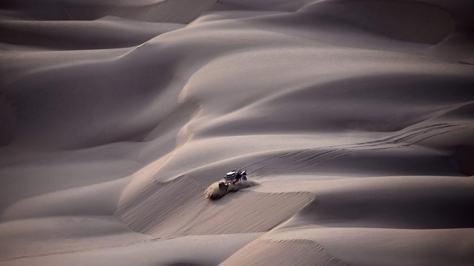 2WD driver Eugenio Amos and co-driver Sebastien Delaunay plough through the dunes of Tanaca. (Franck Fife / AFP)