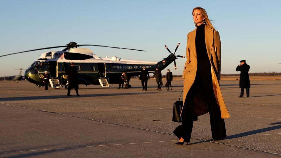 Ivanka Trump walks from Air Force One to a waiting vehicle upon arrival, as US President Donald Trump boards Marine One in the background at Joint Base Andrews in Maryland, US on January 18. (Kevin Lamarque / REUTERS)