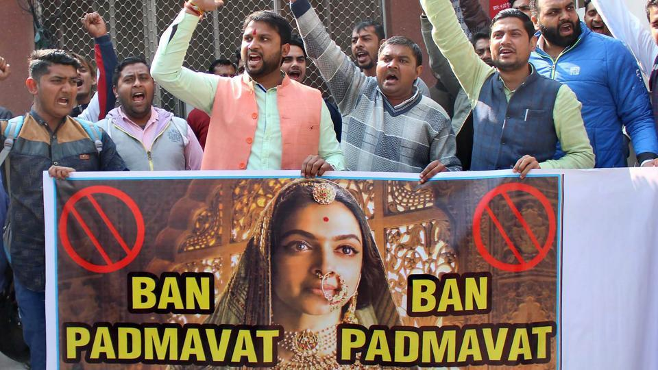 People hold a banner during a protest demanding ban over the screening of film 'Padmaavat' in Meerut.