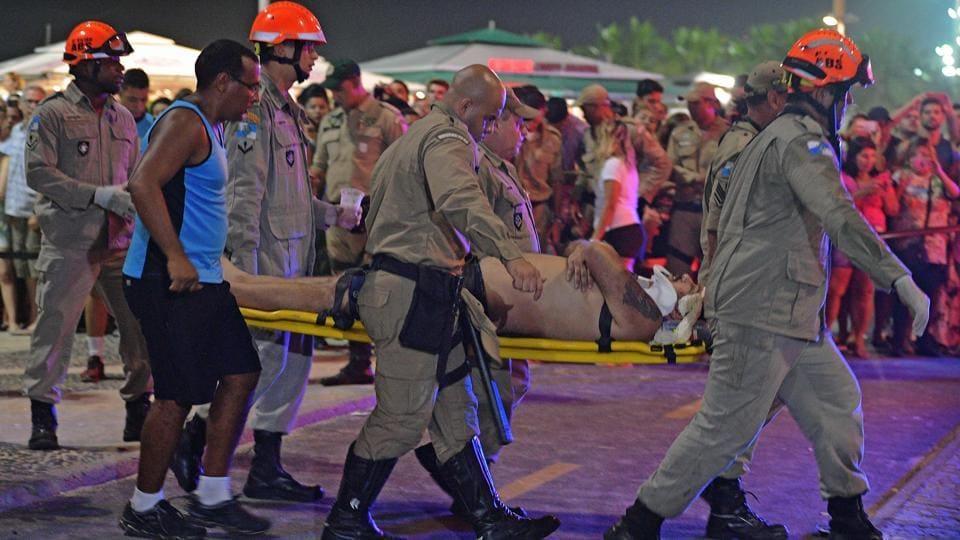 An injured man is taken away by stretcher at Copacabana beach in Rio de Janeiro on January 18, 2018.