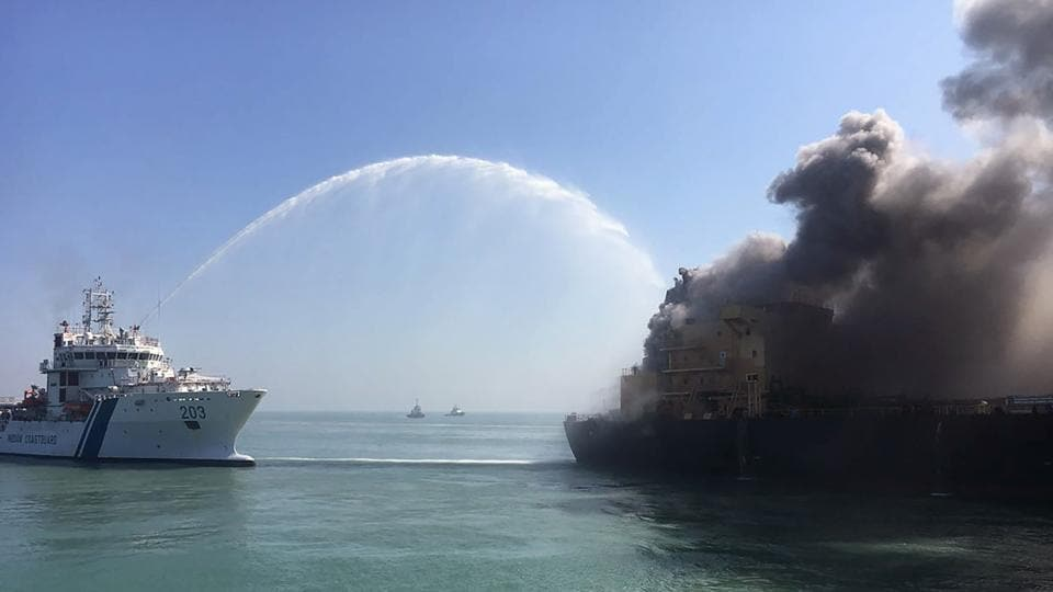 The Indian Coast Guard attempts to contain a major fire on the MT Genessa oil tanker near Kandla Port in Gujarat. The Indian Coast Guard said on January 18, 2018 it had evacuated 26 crew members of the oil tanker after a fire broke out, and that a water sample test showed no sign of spillage from the vessel's cargo of 30,000 tons of diesel fuel. (Gujarat Defence Ministry / AFP)