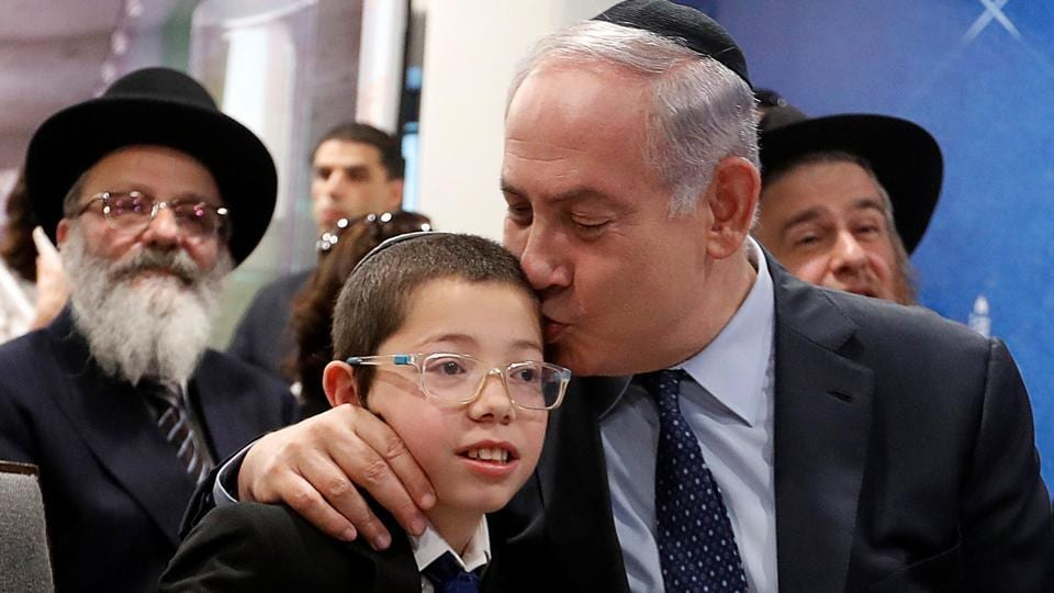 Israeli Prime Minister Benjamin Netanyahu (R) kisses Moshe Holtzberg, who survived during the 26/ 11 attacks, at Chabad House in Mumbai on January 18, 2018. (Danish Siddiqui / REUTERS)