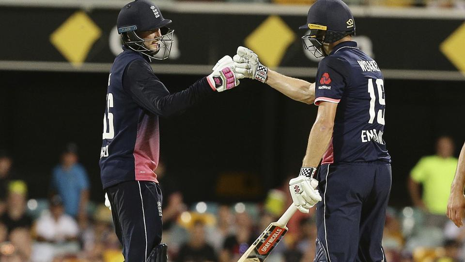 England's Joe Root, left, and Chris Woakes, right, celebrate after winning the sedcond ODI against Australia in Brisbane on Friday.