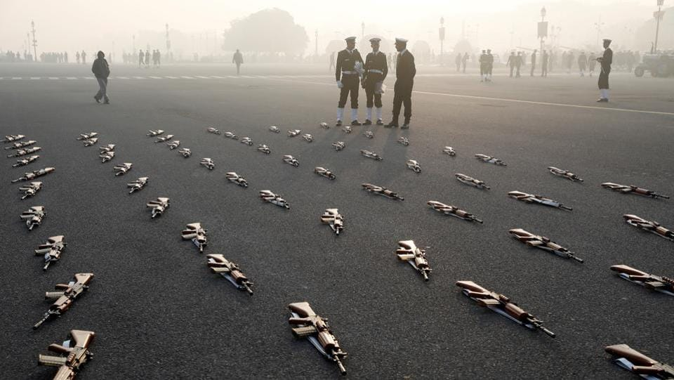 Indian Navy soldiers stand by rifles lined as placemarkers during rehearsals for the Republic Day parade in New Delhi on January 18, 2018. (Saumya Khandelwal / REUTERS)