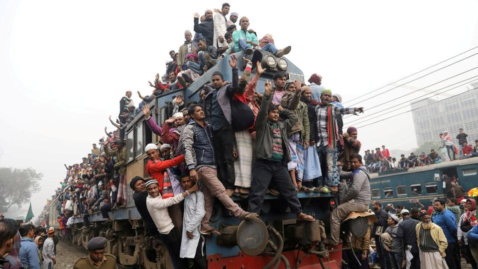 "An overcrowded train leaves Tongi rail station after the final prayer of the first phase of this year's ""Bishwa Ijtema"", an annual theological congregation of Muslims on the banks of the Turag river in Bangladesh on January 14. (Mohammad Ponir Hossain / REUTERS)"