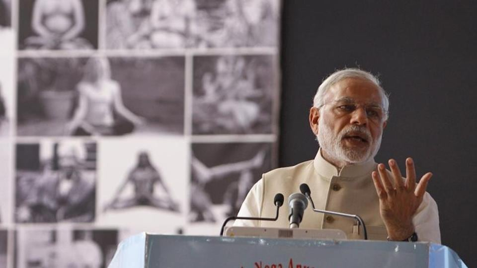 Indian Prime Minister Narendra Modi speaks after inaugurating the International Conference on Frontiers in Yoga Research and its Applications in Jigani, near Bangalore, India.