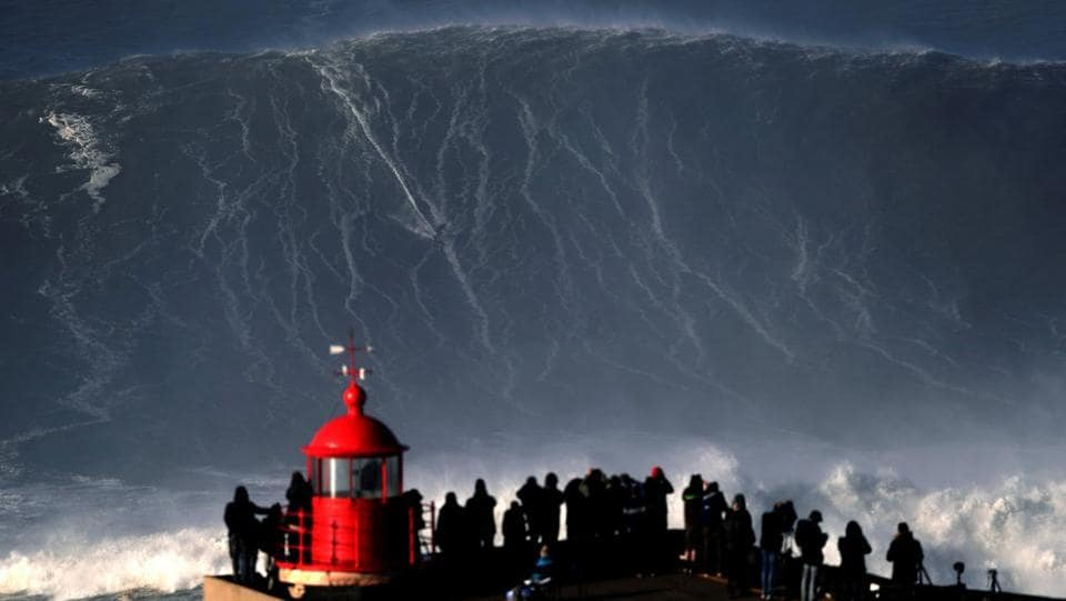 Sebastian Steudtner, a big wave surfer from Germany drops in on a large wave in Portugal on January 18. (Rafael Marchante / REUTERS)