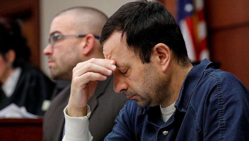Larry Nassar, a former team USA Gymnastics doctor who pleaded guilty in November 2017 to sexual assault charges, listens to a victim during his sentencing hearing in Lansing, Michigan, U.S., January 17, 2018.