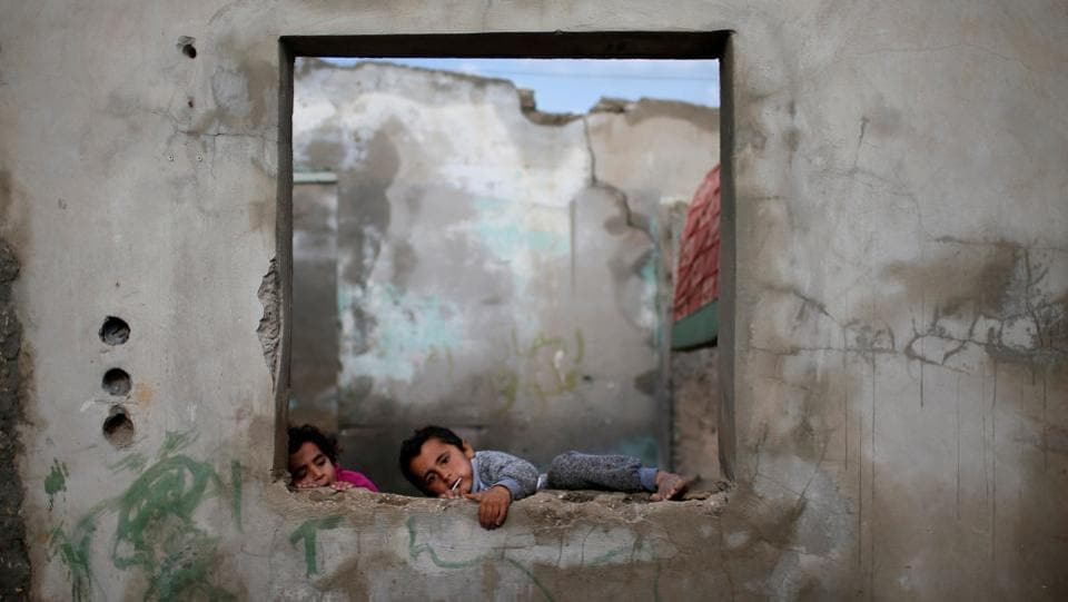 Palestinian children play in their house at the Al-Shati refugee camp in Gaza City on January 15. (Mohammed Salem / REUTERS)