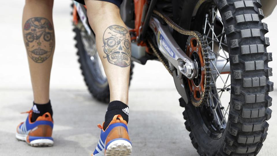 Sam Sunderland, of United Kingdom, pushes his KTM motorbike during technical checks prior to the 2018 Dakar Rally at Las Palmas airbase in Lima, Peru. The 40th edition of the Dakar Rally, the tenth in South America, runs south along the Pacific coast, crossing Bolivia to finish in Cordoba, Argentina on January 20. (Ricardo Mazalan / AP)