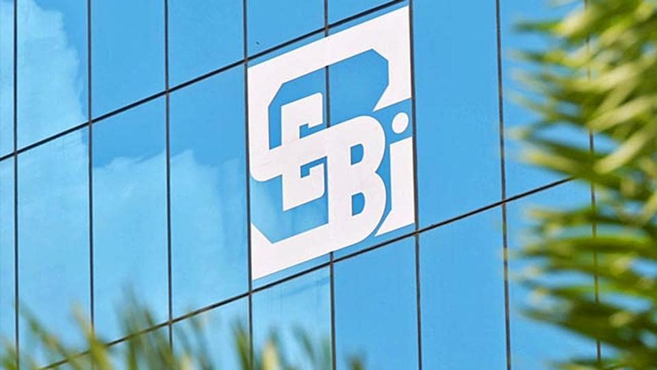 The logo of the Securities and Exchange Board of India (Sebi), country's market regulator, is seen on the facade of its head office building in Mumbai.