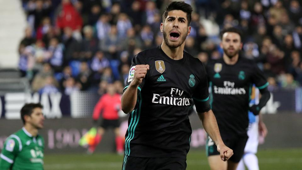 Real Madrid's Marco Asensio celebrates scoring their first goal against Leganes in Copa del Rey.