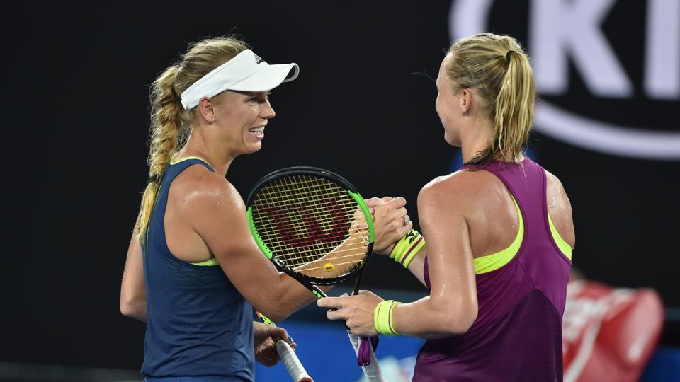 Denmark's Caroline Wozniacki (L) shakes hands with Netherland's Kiki Bertens after their women's singles third round match. The former won 6-4, 6-3. (AFP)