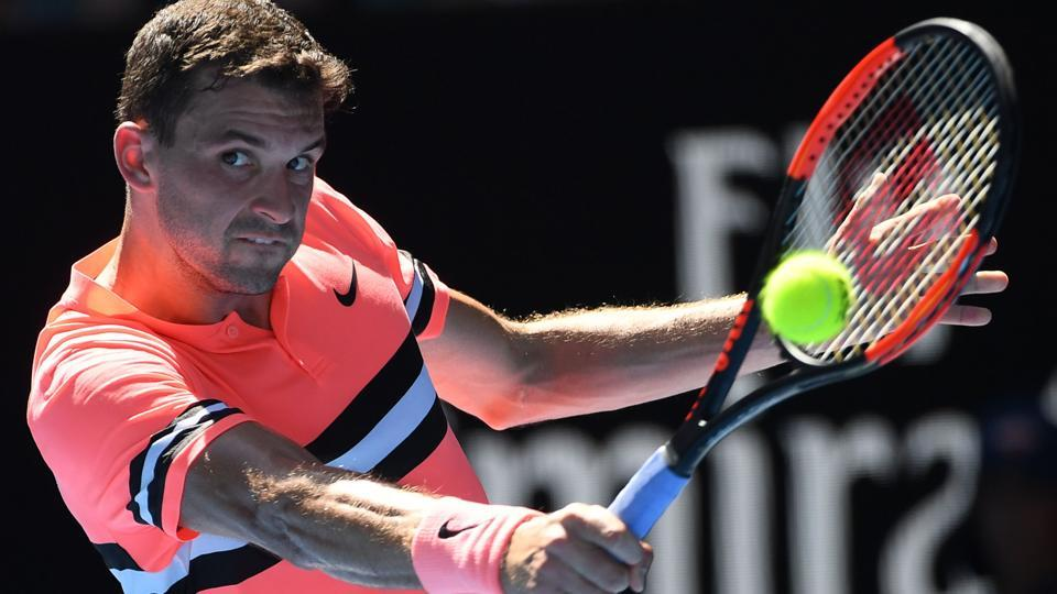 Bulgaria's Grigor Dimitrov hits a return against Russia's Andrey Rublev during their Australian Open tennis encounter.