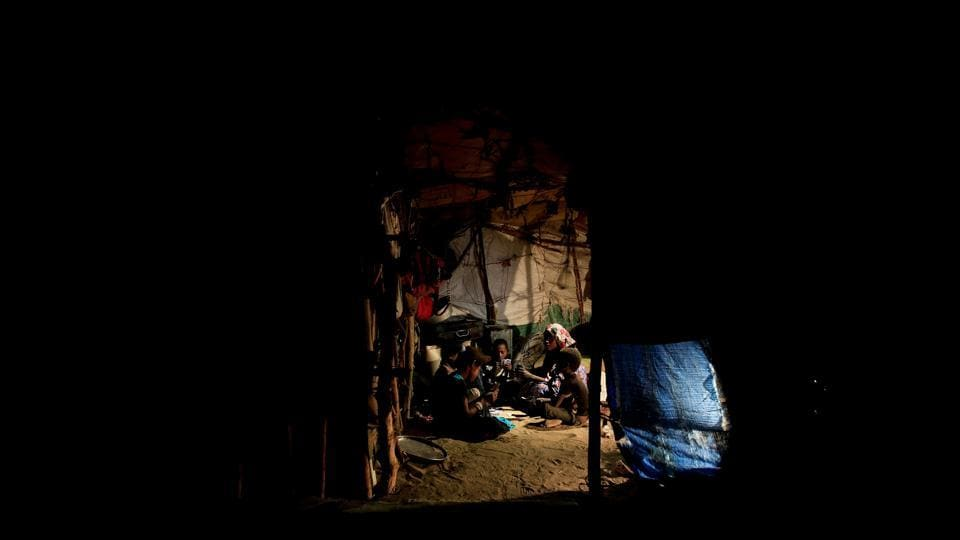 Members of the Ruzaiq family unwind with a game of cards inside their hut. Coalition forces meanwhile have also been advancing along the Red Sea coast, drawing closer to Hodeida, which is a rebel-held city and a key entry point for humanitarian supplies. (Abduljabbar Zeyad / REUTERS)