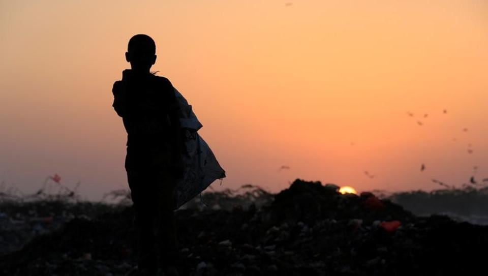 Ayoub Mohammed Ruzaiq, 11, stands atop a garbage mound where he collects recyclables in Hodeidah, Yemen. After persistent Saudi-led air strikes in northwest Yemen, families like Ruzaiq's packed their belongings and fled to the relative safety of Hodeidah on the Red Sea. But with no money, relatives or shelter, his 18-member family joined a growing number of displaced Yemenis living on or next to the city's garbage dump. (Abduljabbar Zeyad / REUTERS)