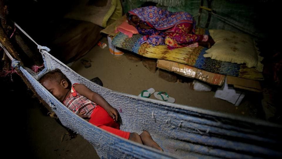 A girl sleeps in a hammock as her sister lies on a makeshift bed in the Ruzaiq family's hut. The Saudi-led coalition denies Houthi accusations that it targets civilians or civilian property in its operations --a root cause to this displacement. (Abduljabbar Zeyad / REUTERS)