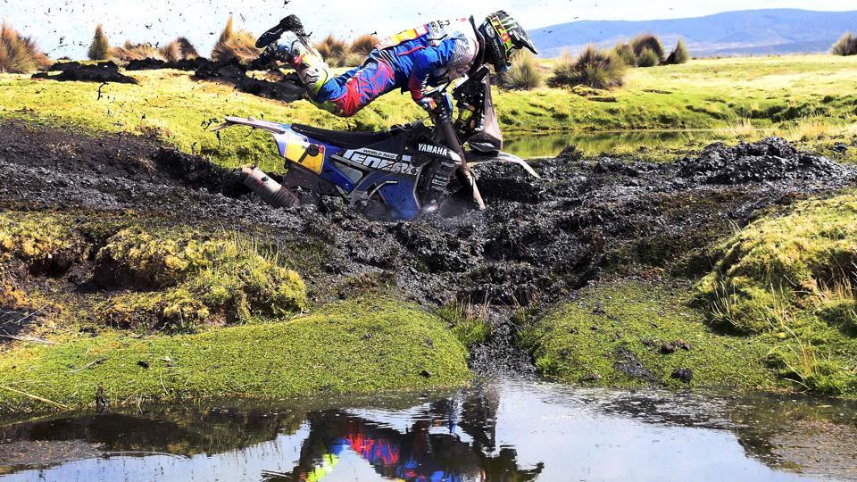 Argentinian biker Franco Caimi is thrown off his bike during a crash into heavy mud during Stage 7 between La Paz and Uyuni, Bolivia. (Franck Fife / AFP)