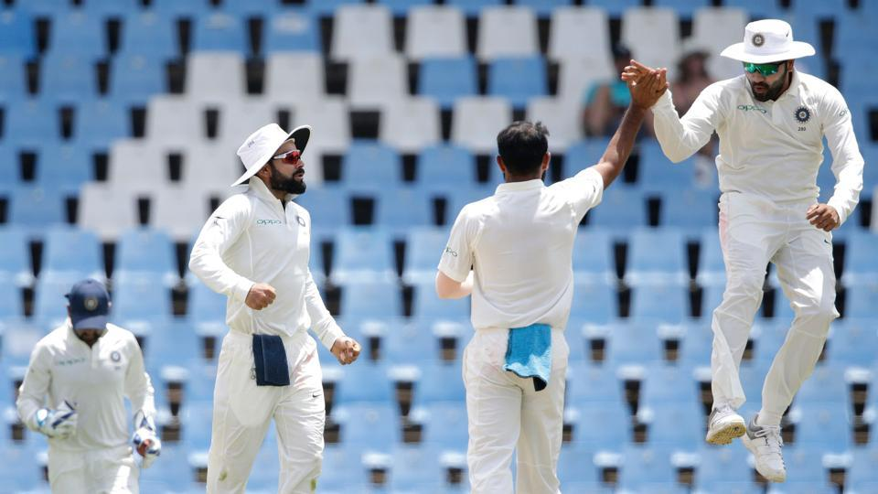 Indian bowler Mohammed Shami (back to lens) celebrates the dismissal of South African batsman Quinton de Kock (not pictured) during the fourth day of the second Test cricket match between South Africa and India at Supersport cricket ground on January 16. (Gianluigi Guercia / AFP)