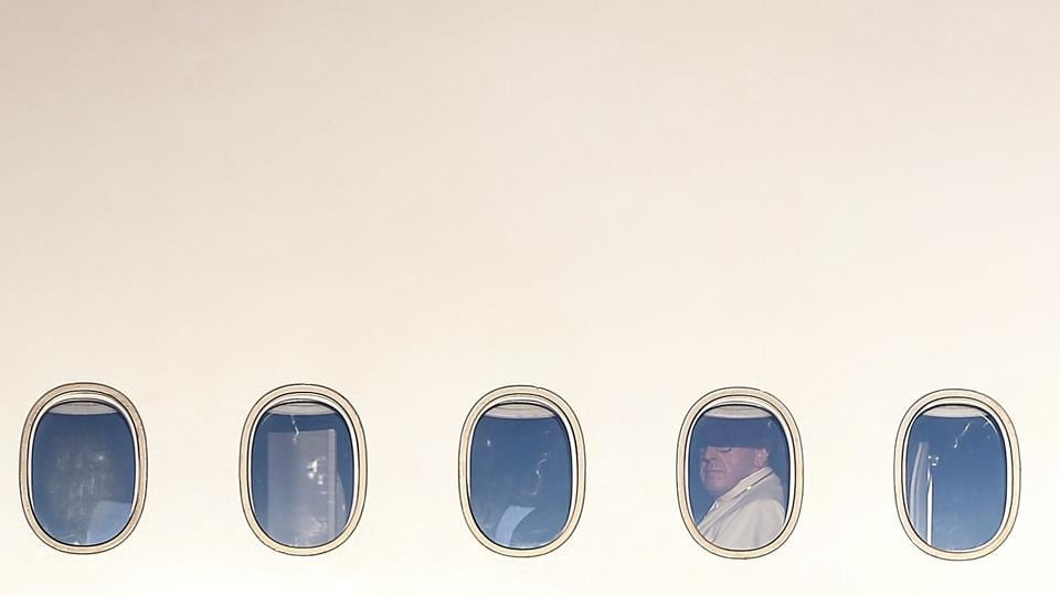 Pope Francis looks out of the window of a plane at Rome's Fiumicino airport on January 15. (Filippo Monteforte / AFP)